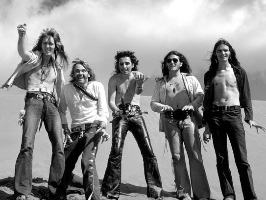 "Pictured are Neal Smith, Glen Buxton, Alice Cooper, Michael Bruce and Dennis Dunaway, the original members of the Alice Cooper group in the early '70s, after writing ""Generation Landslide"" in the Canary Islands."