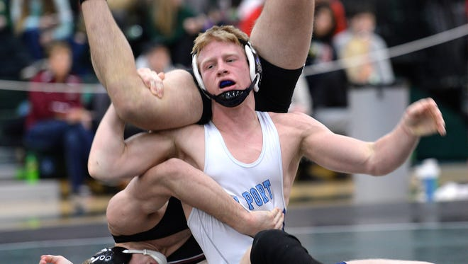 Bay Port's Jack Rathburn, front, flips and readies to pin Pulaski's Matt May in the 145 pound regional finals at Preble High School Saturday.