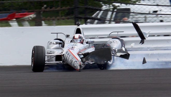 IndyCar driver Juan Palo Montoya (2) hits the wall coming out of turn two during the 100th running of the Indianapolis 500 Sunday, May 29, 2016, afternoon at the Indianapolis Motor Speedway.