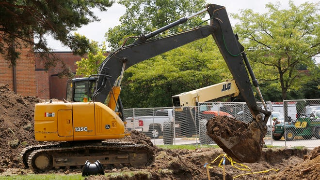 An excavator is used to move soil Wednesday, August 2, 2017, next to Tecumseh Junior High School in Lafayette.
