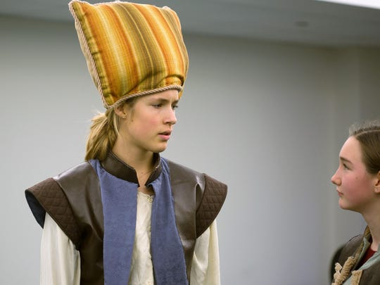 Prince Henry, played by Elena Brotz of Burlington, has a moment of solemnity, realizing the truth about responsibility.