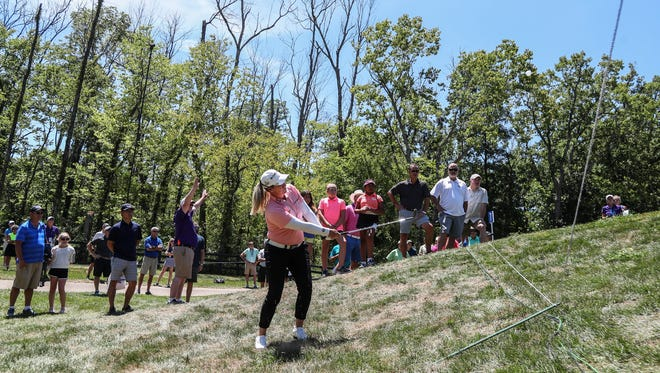 Brittany Lincicome trys to chip her way out of the rough outside the seventh green. She finished 6-over for 78 in 18 rounds of play at the Barbasol Championship.