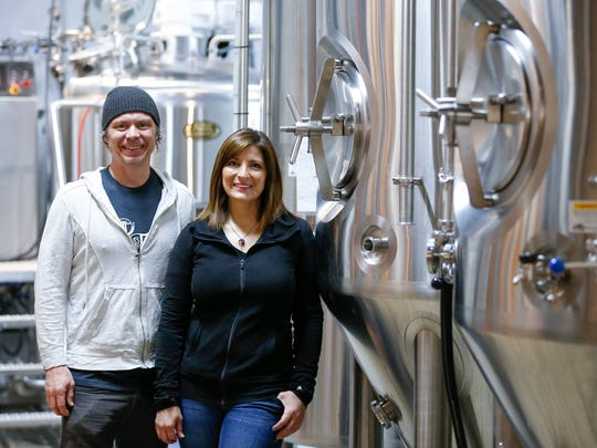 Curtis Marshall and Jen Leonard and holding the grand opening of Tie & Timber Beer Company in the Rountree neighborhood on April 14.