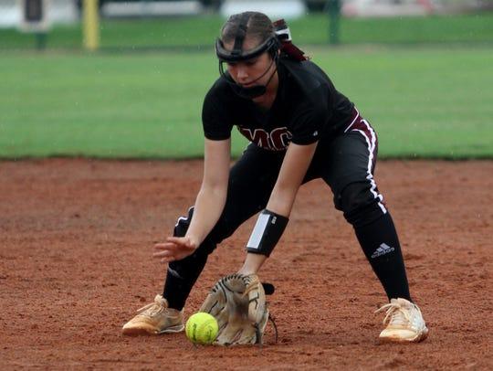 Madison County second baseman Halie Wetherington fields