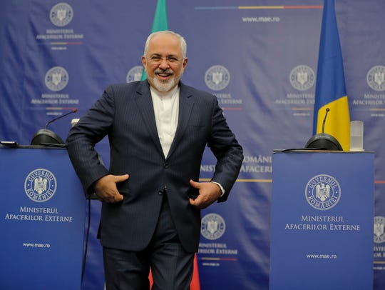 Iran's Foreign Minister Mohammad Shafir smiles at the
