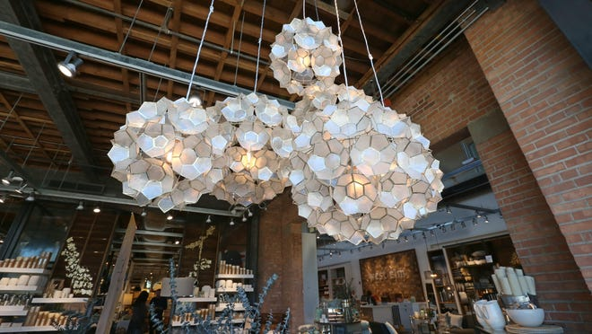 Hand-crafted lights hang in the new West Elm store.