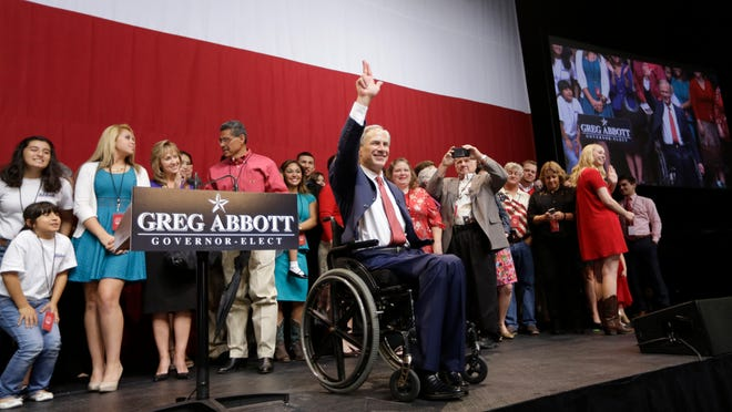 Texas Governor-elect Greg Abbott waves after his victory speech Tuesday, Nov. 4, 2014, in Austin, Texas. Abbott defeated Democrat Wendy Davis to win the race for Texas governor. (AP Photo/David J. Phillip)