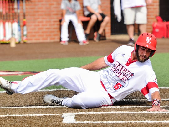 Nick Thurman slides and touches home plate in UL's regular season-ending win over ULM on Saturday.