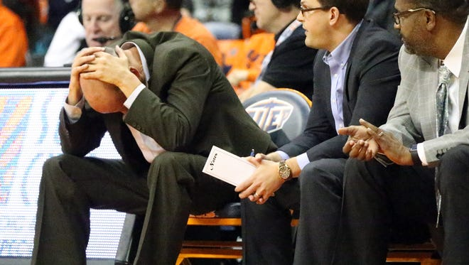 UTEP interim head coach Phil Johnson, left, could't bear to look before the Miners broke the game wide open late in the second half Saturday night.