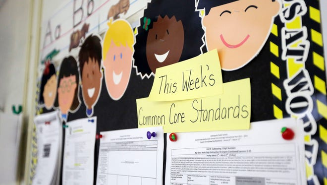 In this March 2013 photo, Common Core standards are posted on a bulletin board in a second-grade classroom at George Buck Elementary School in Indianapolis.