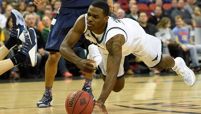 UW-Green Bay guard Charles Cooper (34) dives for a loose ball during a game against Akron at the Resch Center in Ashwaubenon.