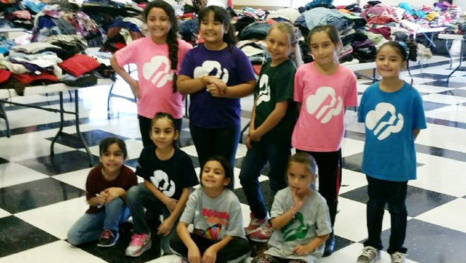 Girl Scout Troop 54370 members recently completed a clothing drive. Scouts participating included Gabby Arciero, standing, from left, Aliyah Muniz, Navaeh Cabrera, Shavelle Ortiz, Aimerie Pena.  Seated from left are Araceli Arambula, Estrella Arambula, Lucy Montenegro and Kamera Ortiz. The Girl Scouts thank the community for the donations and making the clothing drive a huge success.  The girls collected over two tons of clothes donated and more than 100 people in the community came in and picked up donations.  The Girl Scouts also thank the Silver City Police Department, Bayard Police Department, Santa Clara Town Hall, Hurley Town Hall and First New Mexico Bank for accepting the donations.