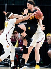 Mar 2, 2018; Indianapolis, IN, USA; Minnesota Golden Gophers guard Gadiva Hubbard (34) knocks the ball away from Iowa Hawkeyes forward Megan Gustafson (10) in the first half during the third round of the Big Ten Conference Tournament at Bankers Life Fieldhouse.  Mandatory Credit: Marc Lebryk-USA TODAY Sports