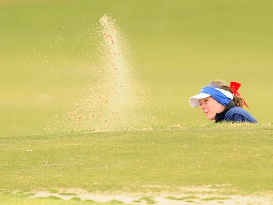 Cooper's Bridget Miller hits out of a bunker during