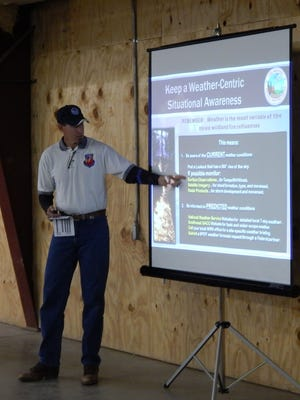 Tom Bird, Fire Weather Program Leader for the El Paso National Weather Service office in El Paso, recently addressed approximately 60 ranchers and county residents during the South East New Mexico Prescribed Burning Workshop and Information meeting in Capitan.