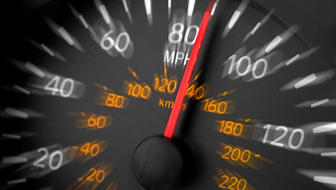 A speedometer reading over 80 mph with motion blur.  Please see my portfolio for other automotive related images.