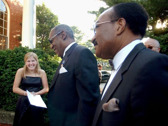 Abby Bland, a senior at the University of Mary Washington, greets Bill Cosby as he arrives to a fundraising event Sept. 24, 2004, in Fredericksburg, Va., for the National Slavery Museum with Professor Gerald Foster.