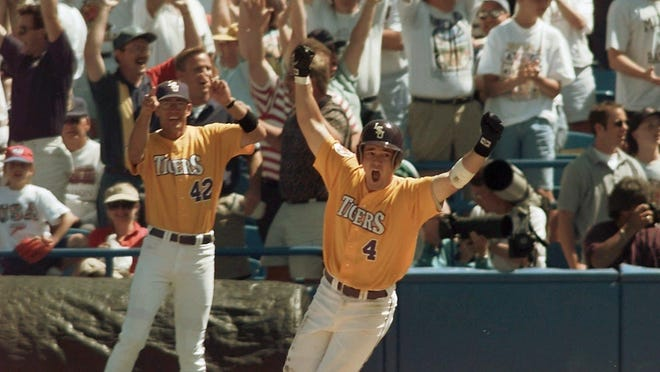 LSU's Warren Morris (4) starts to celebrate as he rounds first base in front of assistant coach Daniel Tomlin after hitting a two-run, bottom-of-the-ninth home run to win the national championship against Miami at the College World Series on June 8, 1996. LSU won 9-8.
