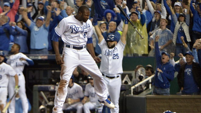 Lorenzo Cain roars across home plate with the go-ahead run in the bottom of the eighth inning for Kansas City.