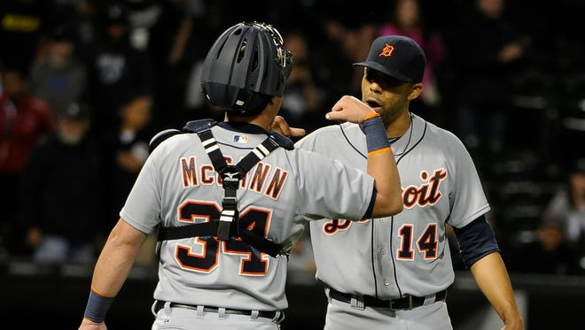 Detroit Tigers starting pitcher David Price (14) and catcher James McCann (34) celebrate their 7-1 victory over the Chicago White Sox on June 6, 2015, in Chicago.