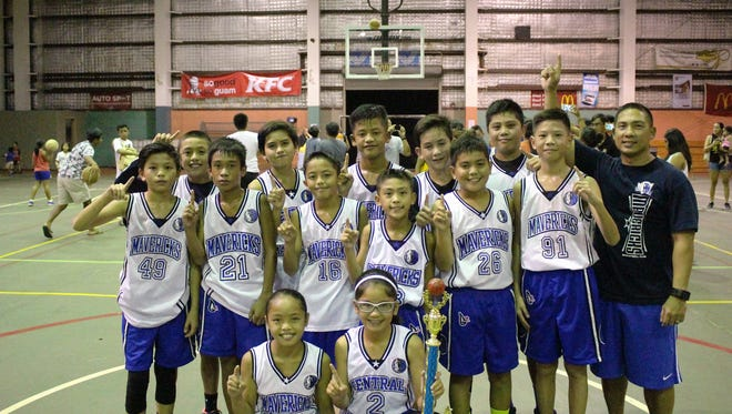 In this file photo, The Mavericks White smile after winning the under-12 division of the Guam Youth Basketball Association Drug-Free Youth Basketball League Aug. 6 at Astumbo gym.