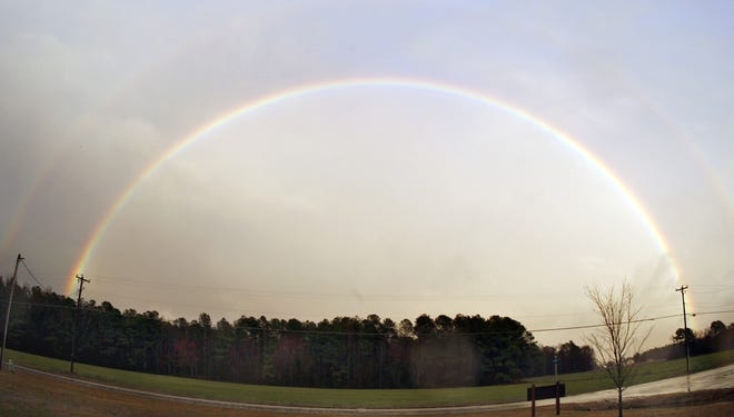 A double rainbow appears across the sky in Pikeville, N.C.