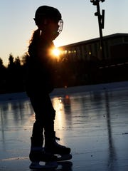 A skater rounds a corner on the ice skating pond Thursday