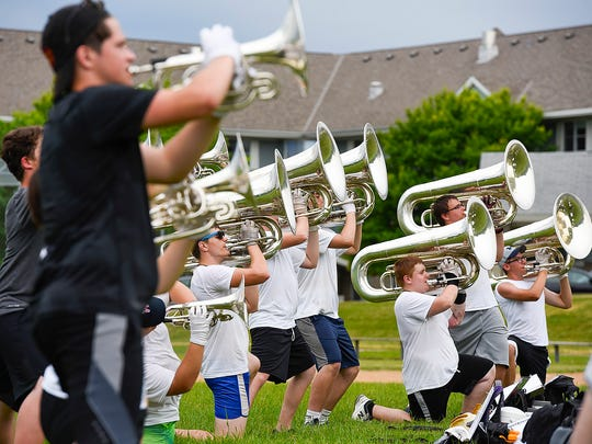 Members of the River City Rhythm Drum & Bugle Corps work on their routine Monday, June 12, during a band camp in Cold Spring.