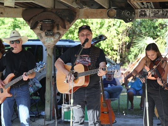The folk duo Florida Boy (Pete Gallagher and Pat Barmore) playing with guest fiddler Laura McGhee. Florida Boy will play at the Smallwood Music Festival on Saturday.