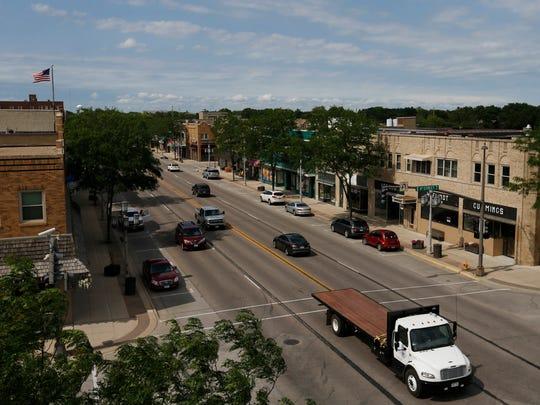 Traffic passes through downtown Spencer, Iowa, on Thursday,