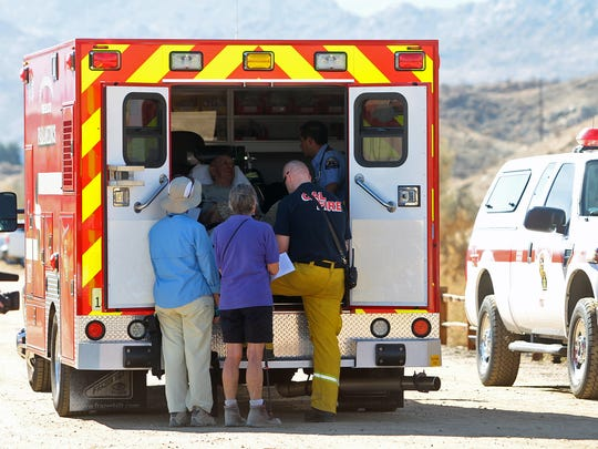 Injured hikers attended to in an ambulance in Palm Desert, Calif.