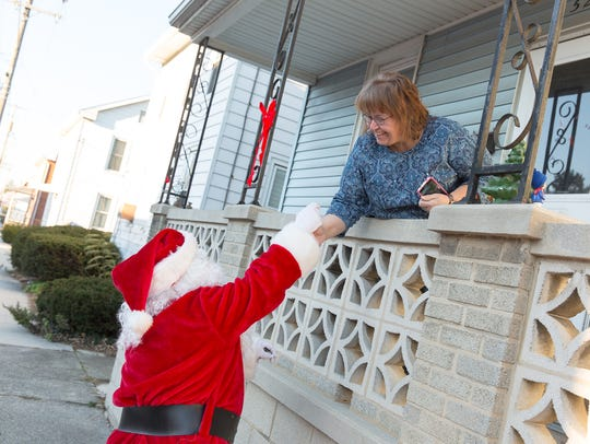 Santa Claus, played by firefighter Wayne Reid, gives