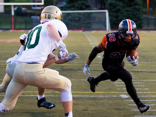 York Suburban running back Jadon Haynes scores a 1-yard touchdown during the second quarter of Friday's game against York Catholic. The Irish won, 20-14.