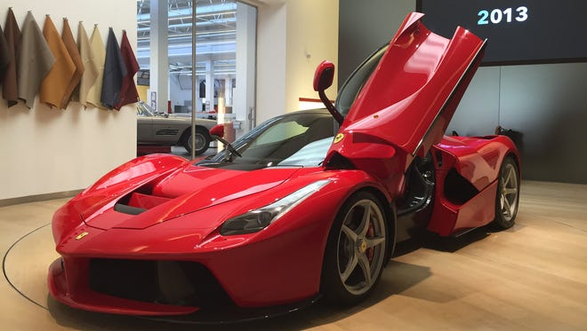 A 2015 Ferrari LaFerrari hybrid car. The LaFerrari is Ferrari's first hybrid. It combines an electric motor that produces over 161 horsepower with a V12 engine that produces 789 horsepower. It costs $1.4 million and only 499 have been made.