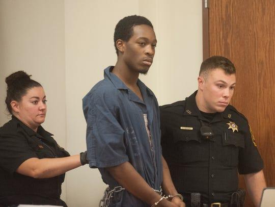 Najuquan Ross walks in custody during a detention