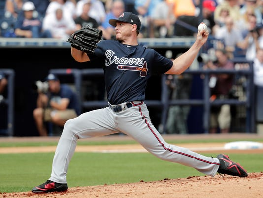 Atlanta Braves starting pitcher Scott Kazmir delivers during the first inning of a baseball spring exhibition game against the New York Yankees, Friday, March 2, 2018, in Tampa, Fla. (AP Photo/Lynne Sladky)