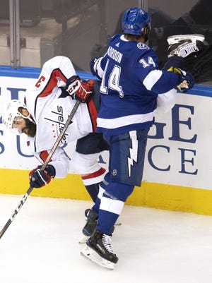 Washington Capitals defenseman Radko Gudas (33) gets upended by Tampa Bay Lightning left wing Pat Maroon (14) during the second period of an NHL playoff game on Monday in Toronto.