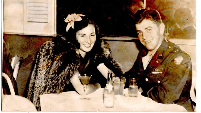 "Benjamin Klein sits with his future wife, Muriel, in a 1942 photo. Benjamin wrote on the photo: ""Our eyes do tell, I so love you."""