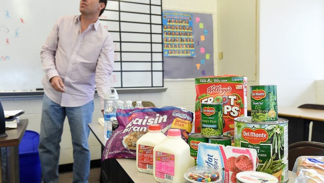 Jeff Quick, CEO of the Food Bank of North Central Arkansas, speaks to students how to shop smart in this file photo. Donations made to the the Food Bank on Valentines will be matched by local philanthropists.