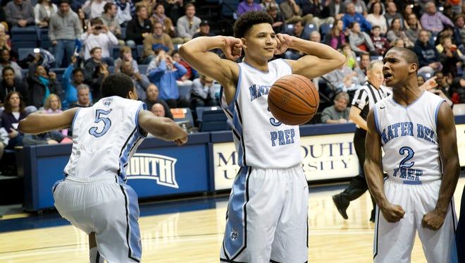 Elijach Barnes celebrates after making a basket during closing second of game.