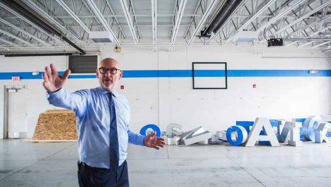Al Gossett, president of Gossett Motor Cars, leads a tour Tuesday of the future Moore Tech Automotive Technician School, located at 2785 S. Mendenhall Road.