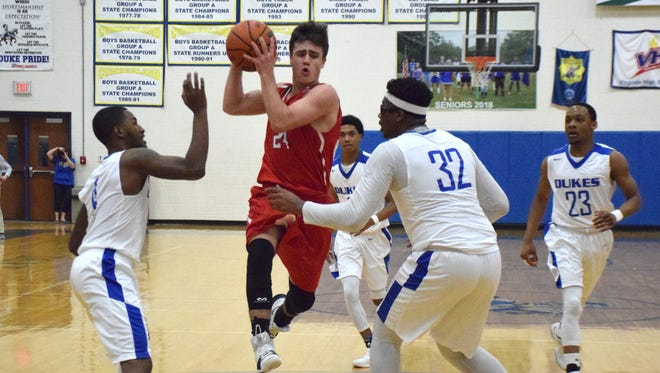 Riverheads' Grant Painter goes between Cumberland's Darius Kyle, left, and Christian Jackson in the first quarter of their VHSL Class 1, Region B championship game on Saturday, Feb. 24, 2018, at Cumberland High School in Cumberland, Va. The Gladiators lost 72-47.