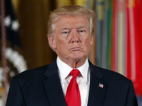 """In this July 31, 2017, photo, President Donald Trump pauses during a ceremony in the East Room of the White House in Washington. Trump's threat to stop billions of dollars in government payments to insurers and force the collapse of """"Obamacare"""" could put the government in a tricky legal situation. Legal experts say he'd be handing insurers a solid court case, while undermining his own leverage to compel Democrats to negotiate, especially if premiums jump by 20 percent as expected after such a move. (AP Photo/Pablo Martinez Monsivais)"""