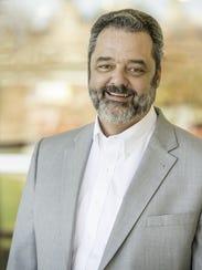 Mark McCoy became the president of DePauw University