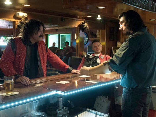 Clyde Logan (Adam Driver, right) makes a martini for