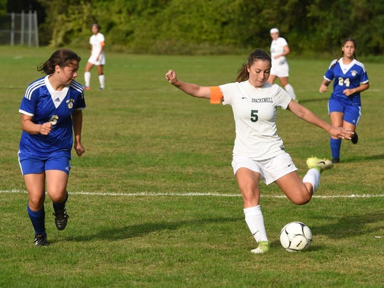 Spackenkill's Caitlin Speranza, right, kicks the ball during Tuesday's game against Ellenville.