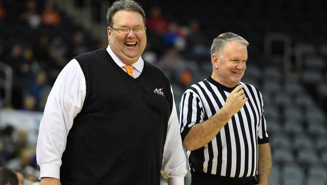 University of Evansville's  Head Coach Marty Simmons shares a laugh with the ref as the University of Evansville plays Illinois State on West Side Day at the Evansville Ford Center Saturday, December 23, 2017.