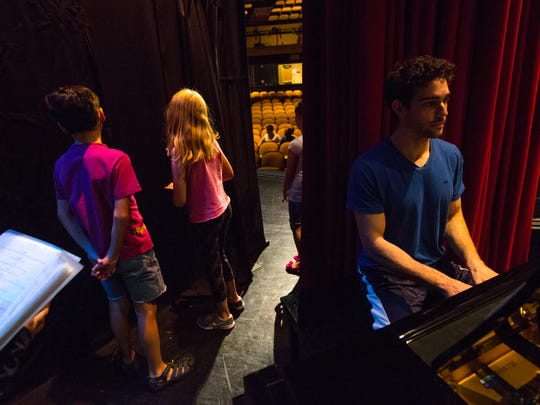 Pianist Mark Klett, right, plays during a rehearsal