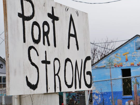 A homemade sign offers words of encouragement along South Alister Street in Port Aransas on Tuesday, Dec. 26. Businesses in the area have been slow to reopen in the four months after Hurricane Harvey hit the Coastal Bend.