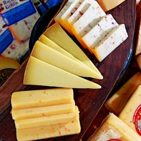 Cheese from Wisconsin Cheese Mart at 215 W. Highland Ave., from bottom to top, Mango Fire, Pleasant Ridge, Bacon Gouda and Gjetost (cq) Cheese, Wednesday, Oct. 5, 2016. Angela Peterson/apeterson@journalsentinel.com